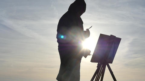 isolated early times artist in hoodie uniform create artwork silhouette Live Action