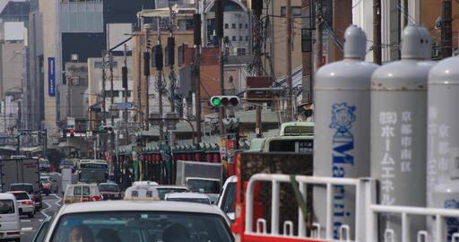 Cars come and go at the downtown street in Kyoto Japan Archivo