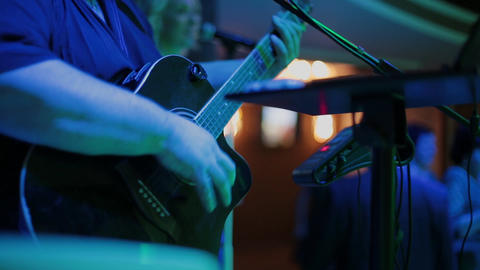 Man playing the guitar,practicing in playing guitar, handsome young men playing Footage