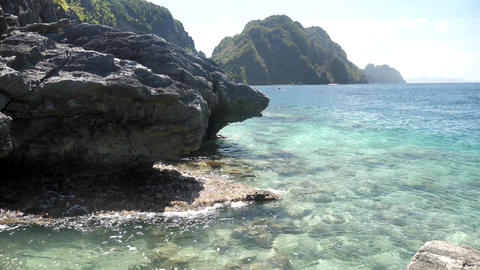 Beautiful shore with rocks and clear water, Live Action