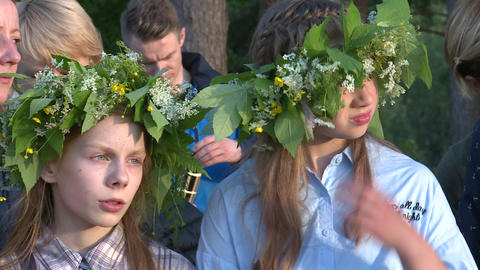 girls with flowers and plants crown at midsummer holiday celebration event Footage