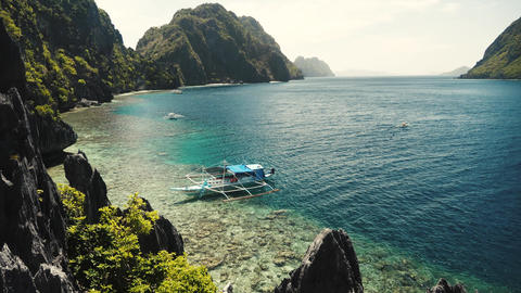Boat and beautiful coast blue water el nido philippines Footage