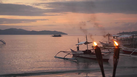 Romantic sunset on the beach with torches in the philippines Live Action