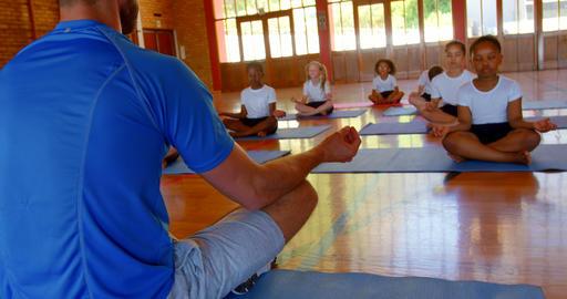 Yoga instructor teaching yoga to school kids in school 4k Live Action