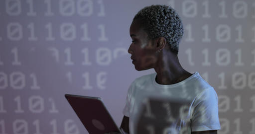 Afro American female programmer in front of coding projection Footage