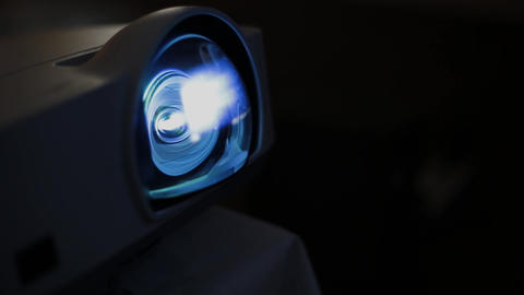 The lens of the modern projector that shines on the screen Stock Video Footage