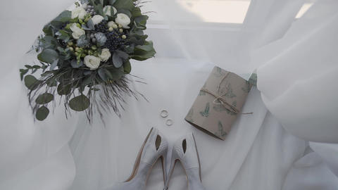 bridal shoes with rings and bridal bouquet Live Action