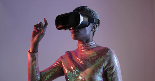 Afro American female using Virtual reality technology in futuristic environment Footage