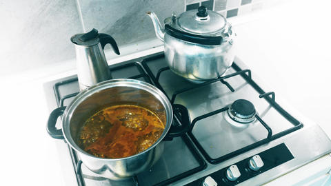 4K Metal Dishes in Kitchen and Boilng Instant Soup Footage