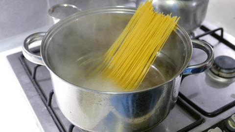 4K Putting Spaghetti into Boiling Water Stock Video Footage
