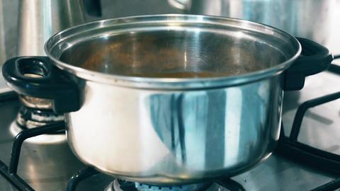 4K Food Being Prepared on Gas Stove Footage
