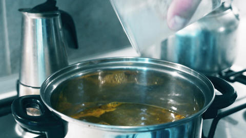 4K Pouring Instant Soup into Boiling Water in Metal Pot Stock Video Footage