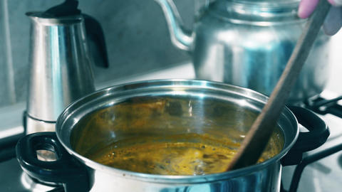 4K Stirring Intsant Soup in Metal Pot Stock Video Footage