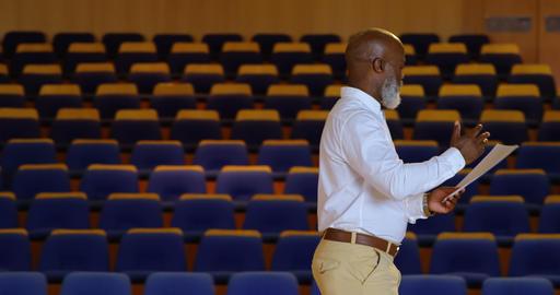 African American businessman practicing speech in empty auditorium 4k Live Action