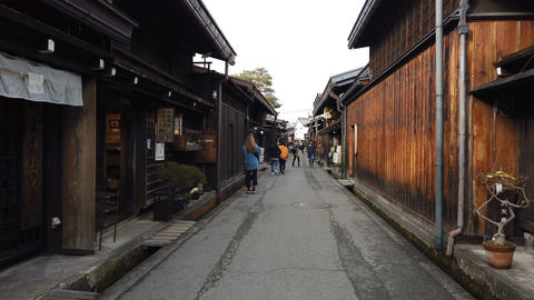 Tourists walking in old town and traditional Japanese village in Takayama Footage