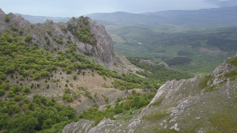 Aerial. Flying over Mountains, rocks and forests. Amazing view of Crimea Live Action