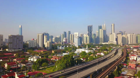 Aerial view of Kuala Lumpur Downtown, Malaysia and highways road. Financial district and business Live Action
