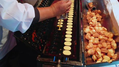 Baking mini pancakes on a Japaneses street food festival Footage