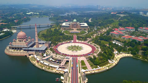 Aerial view of Putra mosque with garden landscape design and Putrajaya Lake, Putrajaya. The most Footage