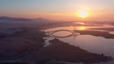 Air view, Drone Shot of Bicycle Bridge and sunrise in South Korea.A place to watch the sunrise in Live Action