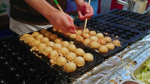 Preparation and street food sale of Japanese specialties Footage