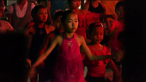 Dancing Chinese childrens crowd in the square at night Stock Video Footage