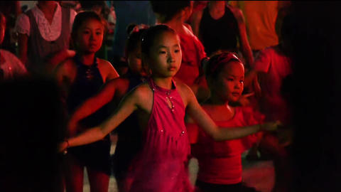 Dancing Chinese childrens crowd in the square at night Footage