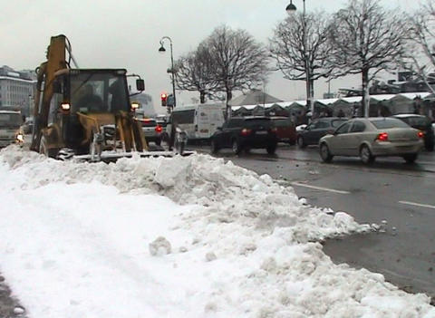 Excavator clears snow Footage