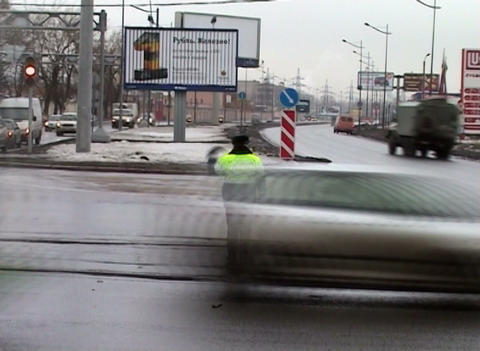 Policeman controls traffic at the crossroads Footage