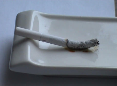 Decaying cigaret in an ashtray Stock Video Footage