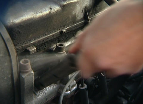 Caps on spark plugs Stock Video Footage