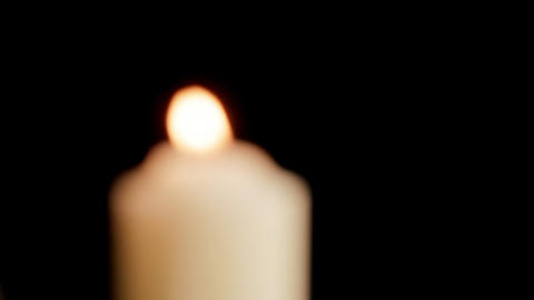 Candle comes into focus Stock Video Footage