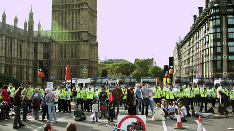 LONDON - OCTOBER 9: Protesters and unidentified policemen near Big Ben on Octobe Footage