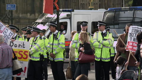 LONDON - OCTOBER 9: Unidentified policemen and protesters near Hungerford Bridge Footage