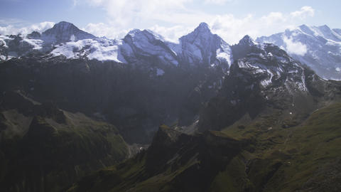 Wide static shot of Swiss Alps and clouds Footage