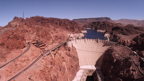 Static shot of hoover dam with cars driving Footage