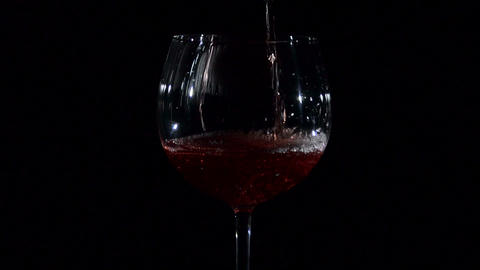 Red Young Wine Pouring into Glass Footage