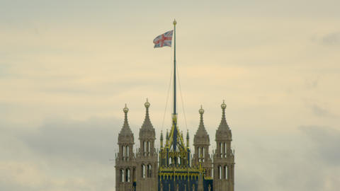 close-up of waving flag on top of Westminster Abbey in London Footage
