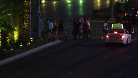 Shot of peole crossing the street in Las Vegas at night Footage