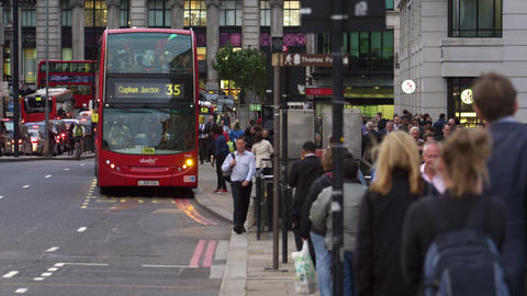 Double-decker bus stopping on a busy street Footage