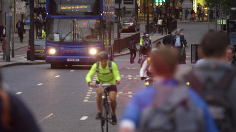 Cyclists in busy London traffic Footage