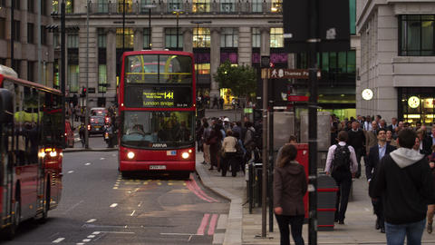 LONDON - OCTOBER 10: Double-deckers drive on a bustling street on October 10, 20 Footage