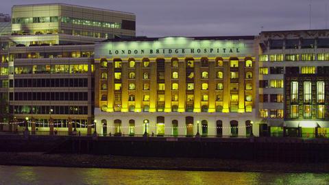 London Bridge Hospital and Thames at dusk Footage