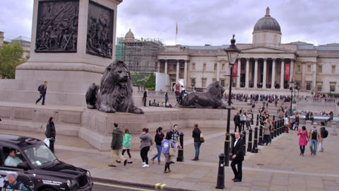 LONDON - OCTOBER 11: Unidentified peopler near the Brass Lions in Trafalgar Squa Footage