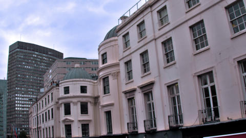Traveling view of buildings along streets in London, England Footage