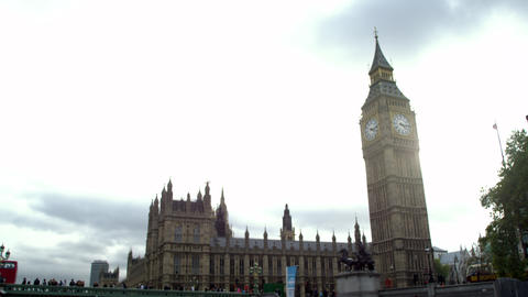 Zoom out view of Westminster palace against cloudy sky in London, England Footage