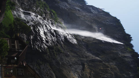 Static shot of misty waterfall in Switzerland town Footage