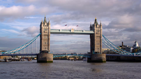 Birds fly over water in front of Tower Bridge in London, England Footage