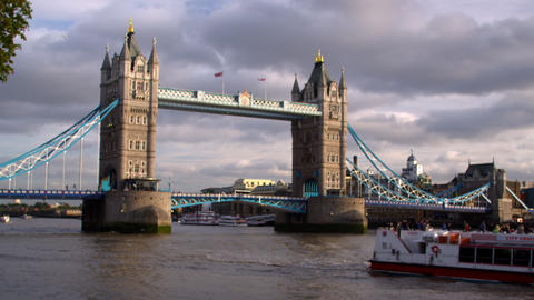 Cruise ship passes by camera with Tower Bridge in background in London, England Footage