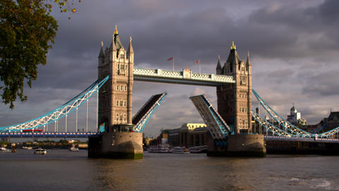 Birds fly in front of Tower Bridge with dark clouds in distance in London, Engla Footage